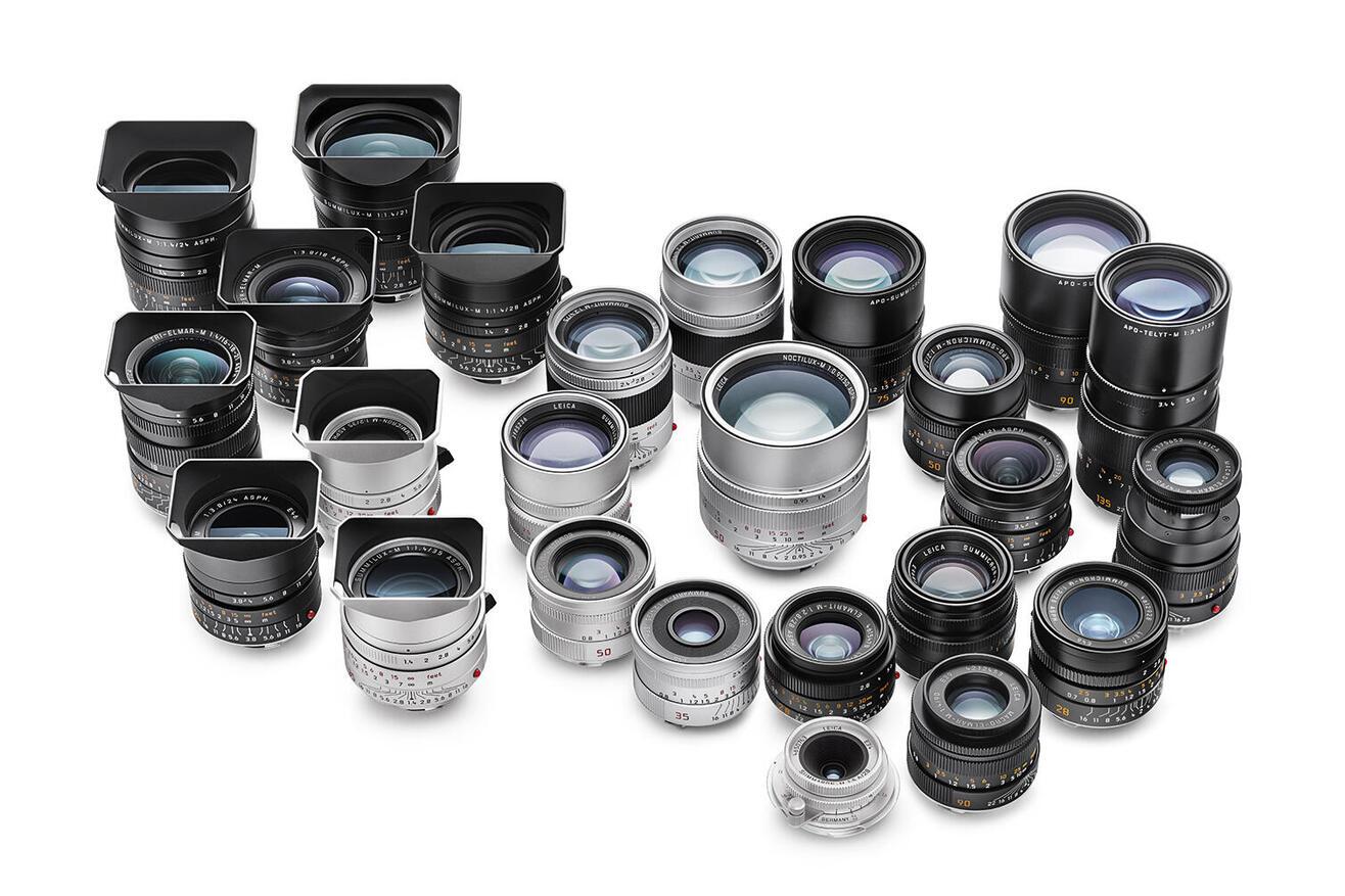 Line up of Leica M-lenses on white background